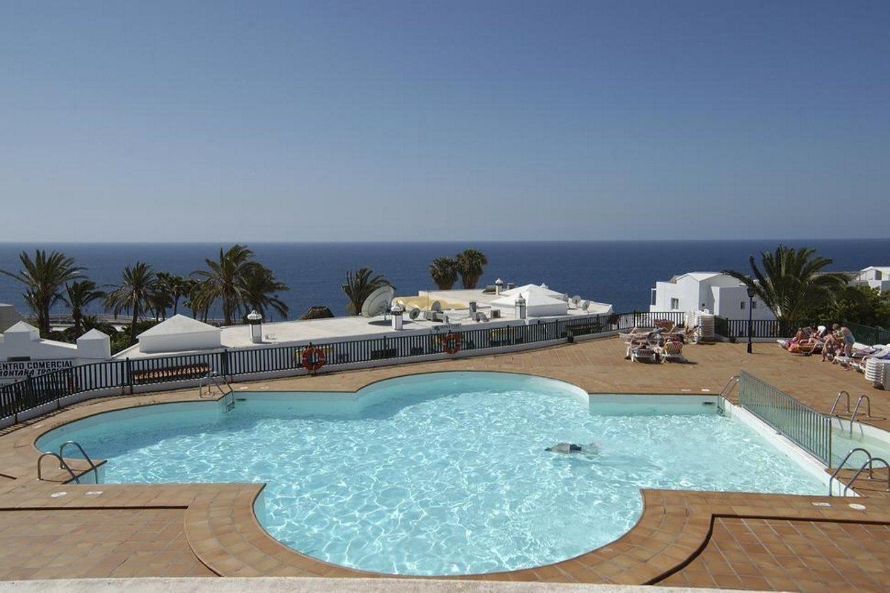 Viajes a lanzarote desde 198 ofertas de vacaciones y - Apartamentos baratos en puerto del carmen ...